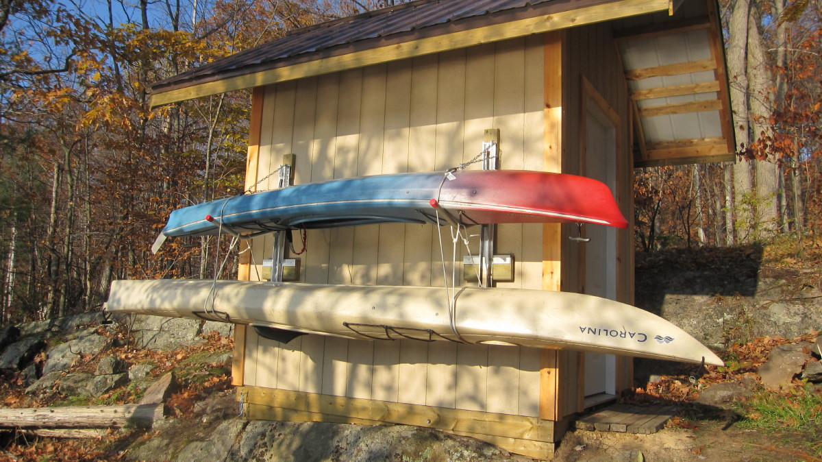 Winter storage on a shed or garage wall & Winter storage on a shed or garage wall - KayaArm Kayak Stabilizing ...